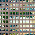 Reflections In Windows Of Office Building by Bryan Mullennix