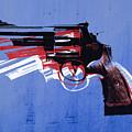 Revolver On Blue by Michael Tompsett