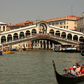 Rialto Bridge In Venice With Gondola by Michael Henderson