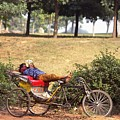 Rickshaw Rider Relaxing by Travel Pics