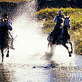 Riders In A Creek by Inga Spence