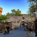 Riding Through Old Town Rhodes, Greece by Global Light Photography - Nicole Leffer
