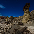 Rim Rock Toadstools Grand Staircase National Monument  by Larry Marshall
