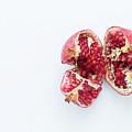 Ripe Pomegranate Fruit On A White Background by Sergii Petruk