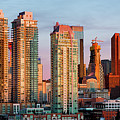 Rising Sun On Calgary by David Buhler