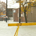 River Flowing Down The Street Hackensack Nj by William Rogers