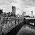 river irwell flowing between manchester on the left and salford on the right Manchester uk by Joe Fox