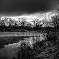 River With Dark Cloud In Black And White by Brenda Landdeck