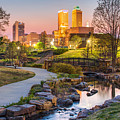 Riverwalk To The Tulsa Oklahoma Skyline  by Gregory Ballos