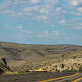Road Through New Mexico Desert High Noon by Colleen Cornelius