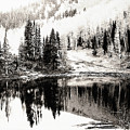 Rocky Mountain Lake - Black And White by Steve Ohlsen