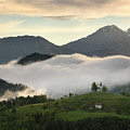 Rolling Fog At Sunrise In The Skofjelosko Hills With St Thomas C by Reimar Gaertner