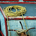Ropes And Rusty Anchors On A Boat Deck by Sami Sarkis