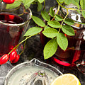 Rosehip Tea With Lemon In Glass by Wolfgang Steiner