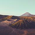 Rugged Mountainous Terrain Mount Bromo At Sunrise by Srdjan Kirtic