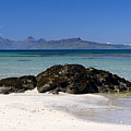 Rum And Eigg From Achateny Beach by John McKinlay