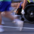 Runners And Disabled People In Wheelchairs Racing Together by Sami Sarkis