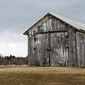 Rustic Barn With Dark Clouds by Nadine Mot Mitchell