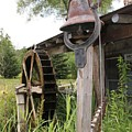 Rustic Bell And Waterwheel by Donna Bosela