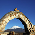 Rustic Church Entrance Archway And Parinacota Volcano Bolivia by James Brunker