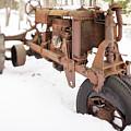 Rusty Old Steel Wheel Tractor In The Snow Tilt Shift by Edward Fielding
