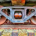 Rusty Wheels by Paul Fell