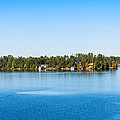 Sailboat And Cottages On Rocky by Panoramic Images