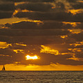 Sailboat As The Sun Sets by John Harmon