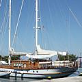 Sailboat In Harbor Summer Vacation Scene by Goce Risteski