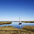Sailboat On Cape Cod Bay by John Greim