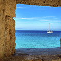 Sailboat Through The Old Stone Walls Of Rhodes, Greece by Global Light Photography - Nicole Leffer