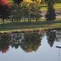 Sailboat With Fall Color Reflections Winona Minnesota by Kari Yearous