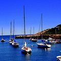 Sailboats Moored In Rockport Harbour. by John Kenealy