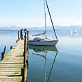 Sailing Boat And Reflection By Lake Pier by Jirawat Cheepsumol