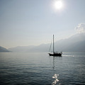 Sailing Boat In Alpine Lake by Mats Silvan