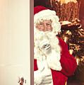 Santa Claus At Open Christmas Door by Amanda Elwell