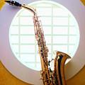 Saxophone In Round Window by Garry Gay