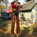Scarecrow Walking On Stilts by Sally Weigand
