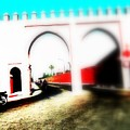 Scootering Through A Medina Gate  by Funkpix Photo Hunter