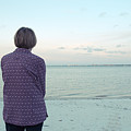 Senior Woman On The Beach  by Edward Fielding