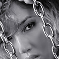 Sensual Woman Face Behind Chains by Oleksiy Maksymenko