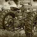 Sepia Toned Old Farmall Tractor In A Grassy Field by Randall Nyhof