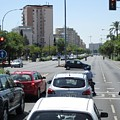 Seville Street Intersection Scene And High Rise Buildings Spain by John Shiron