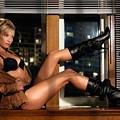 Sexy Woman In Lingerie Sitting On A Window Sill by Oleksiy Maksymenko