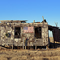Shack With American Flag by John Greim