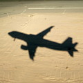 Shadow Of Airplane Flying Into Land by Sami Sarkis