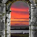 Shannon Sunrise Through Medieval Arch by James Truett