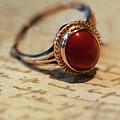 Shiny Ring With Dark Red Stone by Jaroslaw Blaminsky