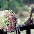 Shoes And Wedding Bouquet by Jan Pavlovski