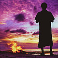 Silhouette Of A Local Man Standing By The Bonfire On The Beach In Maldives During Dramatic Sunset by Srdjan Kirtic